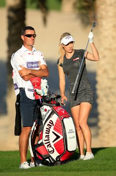Paige Spiranac and Bryan Smyth Photos Photos - Paige Spiranac of the United States chooses her club for her second shot on the par 4, 14th hole with her caddies Bryan Smyth during the second round of the 2015 Omega Dubai Ladies Masters on the Majlis Course at The Emirates Golf Club on December 10, 2015 in Dubai, United Arab Emirates. - Omega Dubai Ladies Masters - Day Two