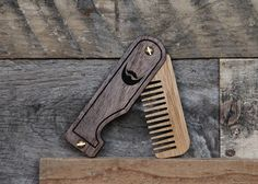 This is a small handmade beard comb that is crafted with walnut scales which can be personalized with your favorite initials, nickname, or...