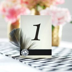 modern glam wedding: feather table number