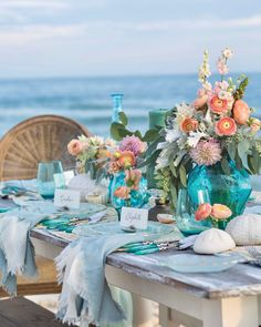 White sand and blue waves influence a glimmering tablescape that features dinnerware reminiscent of sea glass with nautical accents. #southernladymag #tablescape #tablescapes #tabletop #tablescapestyling #styling #tabletopinspo #seaglass #coastal #seaside #ocean
