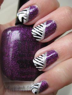 I like these purple and zebra striped nails.