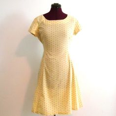 """Vintage Prairie Dress Knee Length Calico Yellow Cute and cool cotton dress with a little puff to the short sleeves. Zips up the back with a nylon zipper.  It ties from the waist at the back to show off your shape.     Material: Cotton and nylon zipper (feels like soft well washed cotton sheets) Color/print: Yellow with tiny roses with green stems Era: 60's or 70's  Size:   M  L  Bust-   37""""  Waist-  34""""  Length-  35"""" Sleeves- 1"""" Condition: Good condition, no rips, stains and seams all in…"""