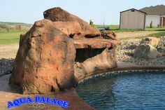 Custom grotto water fall feature on vinyl liner pool. This design hides the heat pump and filter system.  Aqua Palace  810 Woodbury Ave  Council Bluffs, Iowa 51503  712-329-4180  www.aquapalace.com