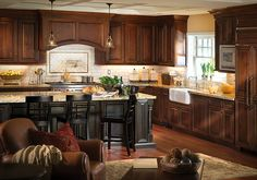 traditional kitchen with wooden cabinets and black countertops Kitchen And Bath, New Kitchen, Kitchen Dining, Kitchen Decor, Kitchen Ideas, Dining Room, Kitchen Island, Wooden Cabinets, Kitchen Cabinets