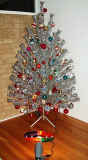 Everyone had one... it had a color wheel light because you couldn't put string lights on the metal branches.
