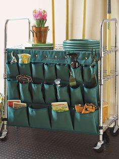 Designed to coordinate with our renowned garage shelving, this durable organizer holds over 60 gardening tools of various sizes.