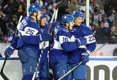 Mitch Marner #16 of the Toronto Maple Leafs celebrates his go ahead goal with teammates during the third period of the 2017 Scotiabank NHL Centennial Classic against the Detroit Red Wings at Exhibition Stadium on January 1, 2017