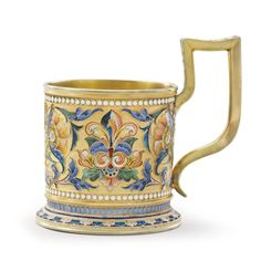 Sotheby's A SILVER-GILT AND CLOISONNÉ ENAMEL TEA GLASS HOLDER, VASILY AGAFONOV, MOSCOW, 1899-1908