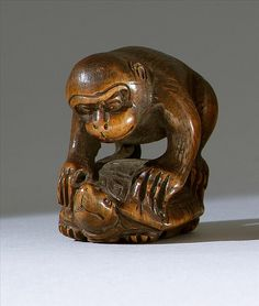 """WOOD NETSUKE 19th Century In the form of a monkey riding on the back of a tortoise. Height 1.5"""" (3.7 cm)."""