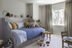 A cozy upholstered bed in Luca's Playfully Parisian Bedroom