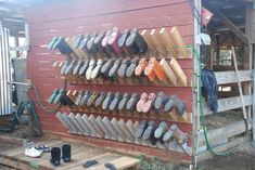 Dedicate one wall for mucky boots, another for everyday and dressier boots...