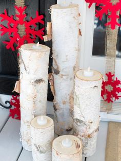 Create an All-Natural Ambiance--  To add a twinkling light effect around the entry, a birch log was cut down into groupings of luminaries. First, cut a birch log into five different lengths with a circular saw. Next, drill holes inside the tops of each log and place battery-operated votives inside. At night, the votives will cast a twinkling glow into the logs.