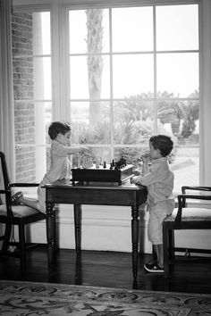 Boys playing chess. Family photography. Lea Austen Photography