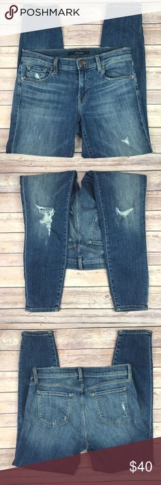 "J Brand Cropped Medium Wash Distressed Jeans J Brand skinny cropped distressed jeans with ripped knees Medium wash. MSRP $228 Material tag is cut off Size 27. Waist 29"" Rise 8"" Inseam 25.5"" Length 34"" Leg opening 10"" Normal wear, no stains or holes. Great pre-owned condition All measurements are approximate. Smoke free home. J Brand Jeans Ankle & Cropped"