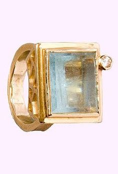 Just Jules ring: 14 Karat yellow gold ring with natural rough cut Aquamarine and diamond accent