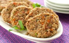 Walnuts add a little crunch and brown rice takes the place of bread crumbs making these savory vegetarian burgers a great gluten-free meal. Serve with a green salad or cooked greens.