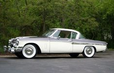 This 1955 Studebaker President Speedster hardtop coupe is described as an unmodified, frame-on restored car that scored 396 out of 400 points at last fall's Studebaker Nationals. These one-year-only cars are among our favorite Studebakers and the colors on this one really look classy. Find it here on eBay in Chicago, Illinois with bidding short of reserve and a $47,000 Buy-it-Now.