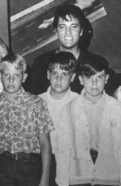 Elvis with his step-brothers 1968.  His little brothers look overjoyed in this picture.