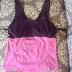 Nike Workout Top Nike - size medium - purple and pink tank top - built in bra - good quality material - v neck detail on front of top and slit accents on back of top - great condition -  bundle discounts available - reasonable offers welcomed Nike Tops Tank Tops