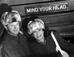 American writer Erskine Caldwell - and his wife, photographer Margaret Bourke-White - both wearing fur hats, pose under a sign that reads 'Mind your head,' Archangelsk, Russia. (Photo by Margaret Bourke-White/Time Life Pictures/Getty Images) Documentary Photographers, Female Photographers, Margaret Bourke White, Dust Bowl, Life Pictures, Soviet Union, Life Magazine, Documentaries, Writer