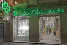 Arenal2 Pharmacy by Marketing Jazz Madrid  The idea came from thinking about how to clearly transmit the selection of products available at the Arenal2 pharmacy. We focused on three elements: The cross, our product and the lighting.  Four shop windows totally filled with products organised by category, colour and shape, where the only empty space is the outline of a cross in LEDs.
