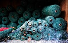 A colourful past: Haunting images of abandoned textile mill show wool still on the looms and stacks of yarn on shelves: Cobwebs cover these abandoned yarns in the abandoned Lerry Mills. These pictures were taken by Dan Circa, 29, after he was intrigued by the mill, located in Tal-y-bont, near Aberystwyth, Wales