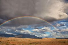 Rainbow Over The Karoo - A rainbow over The Karoo National Park in South Africa. A rainbow over The Karoo National Park in South Africa. This is a semi-desert natural region of South Africa. It has two main sub-regions - the Great Karoo in the north and the Little Karoo in the south. The 'High' Karoo is one of the distinct physiographic provinces of the larger South African Platform division. The Great Karoo has an area of more than 400,000 square kilometers. From a geological point of view…