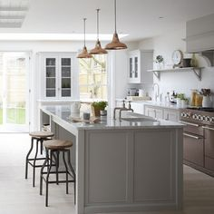 Another fav. Mid tone grey cabinets with copper accessories