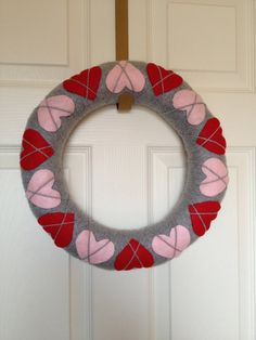 Yarn wrapped Valentine's day wreath with argyle hearts
