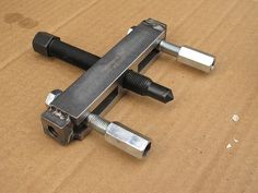 Hub Puller by Rick Anderson -- Homemade hub puller constructed from a steering wheel puller, bolts, and coupling nuts. http://www.homemadetools.net/homemade-hub-puller-2