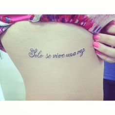 You only live once rib tattoo