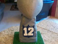 Made for a school fund raiser and it did very well. The actual cake is the pedestal of the trophy. I carved the football out of Styrofoam, the base is also Styrofoam both are covered with gray fondant and airbrushed with silver metallic.