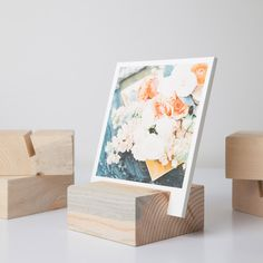 Wedding photos put into a book or a wood block, super cute.