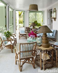 Rattan furniture creates a relaxed living room on the veranda.