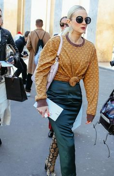 On the streets at Paris Fashion Week. Photographed by Phil Oh.