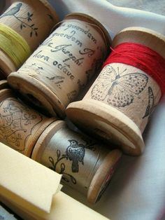 Stamped wooden thread spools.