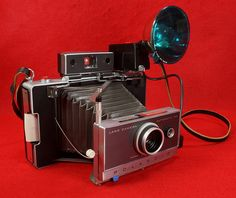 SOLD - Vintage Polaroid Automatic 100 Land Camera with 268 Flash & Case Cheap Cameras, Old Cameras, Polaroid Camera For Sale, Vintage Cameras For Sale, Tin Can Alley, Nikon Dx, Camera Deals, Vintage Polaroid, Best Cameras For Beginners