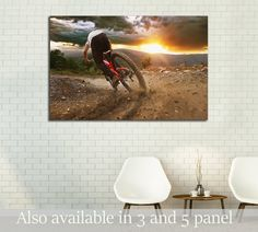 Man on mountain bike rides on the trail on a stormy sunset     №3252