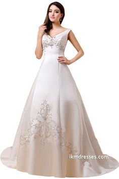 http://www.ikmdresses.com/V-Neck-Beaded-Lace-up-Bridal-Ball-Gown-Wedding-Dresses-p88028