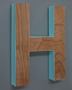 Fake a wood look monogram with a craft letter, colorful paint, and wood veneer!  #DIHWorkshop