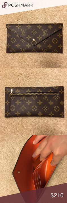 Louis Vuitton envelop wallet/clutch 100% authentic, never use. Brand new condition, do not have box or bag. They are about 8.5 inches by 4.5 inches, my iPhone 6 Plus can loosely fit in, has 6 cards clots, 2 dividers, for cash and phone, also have coin clots in the back, can be used as clutch for night out. Cross posted, grab it before it's gone. Price is firm. Louis Vuitton Bags Wallets