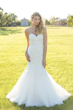 Adore this strapless mermaid gown with floral detailing! #MadisonJames #WeddingDress @allurebridals