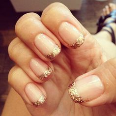 Can't get enough of gold? Check this amazing gold and glitter inspired French tip nails. The nails start with a clear polish as the based and later on tipped with a gold coat and accented with glitters.