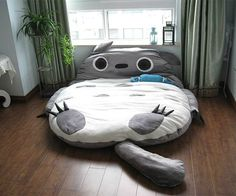 Totoro cushion bed.. probably will never have a place for this (maybe in the family room?) but it's so cute
