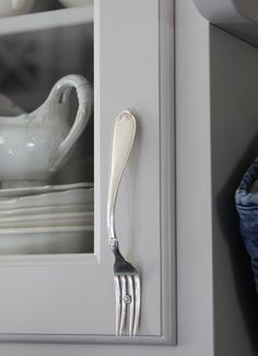 Upcycle silverware into cupboard knobs! How great is that? #upcycle #reuse #kitchendecor #cabinets