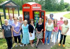 The community of Mellis have got together to create coloured glass panes which have gone into a red phone box.