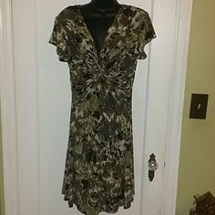 Black, 2 shades of camo green & off white It has a tie in middle of breast and  rousing material. stretchy and very forgiving. Beautiful  dress Connected apparel Dresses