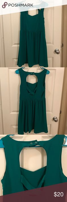 Emerald Dress Adorable dress with a fun cut-out back. Great to wear to weddings or any celebratory occasion!  Dry clean only. 100% polyester. Francesca's Collections Dresses Midi