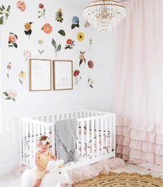 These florals add such a fun + fancy pop of color in this sweet room. 🌺 We love them paired with ruffles + a chandy for an ultra-femme space! Editor's Note: This nursery is for a toddler. Little babies sleep safest in an empty crib with only a tight-fitting crib sheet. 📸: @stephanielee130 Nursery Design, Nursery Decor, Bedroom Decor, Nursery Ideas, White Rooms, White Walls, Baby Decor, Kids Decor, Baby Wall Decals
