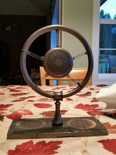 Antique microphone built by Greg from towel ring, springs, zip ties, and shower heads